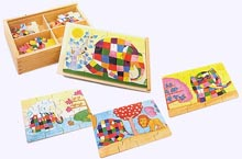 Four Elmer wood puzzles in a box